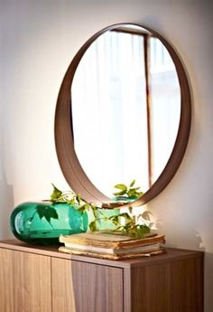 The new STOCKHOLM collection: A walnut veneer edged mirror has a deep bottom ledge that also serves as a handy spot for small items.