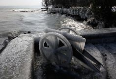 An old cannon completely covered in ice, on a windy winter day near the harbor of Versoix, Switzerland, on February 3, 2012. (Reuters/Denis Balibouse)