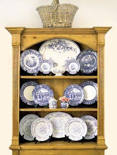 All Symmetrical Here, an arrangement of blue-and-white plates and platters gains interest from a range of blue tones and a variety of sizes, framed in a vintage-look pine cupboard Dish Display, China Display, Plate Display, Displaying China, Shelf Display, White Dishes, White Plates, Blue Plates, Wall Mounted Display Cabinets