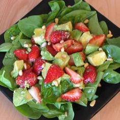 Another one to try this weekend...Strawberry Avocado Salad on a bed of Spinach