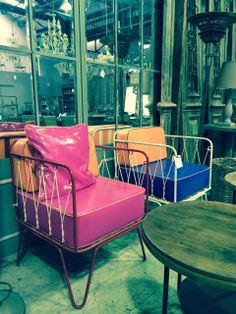 Outdoor / indoor steel rope chairs. Painted in bright colours with optional cushions. Sitting in front of our panel mirror. All available at Le Forge 59 Denison Street, Camperdown NSW Australia www.leforge.com.au