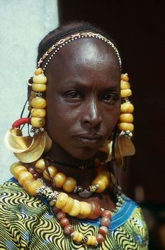 Portrait of a Fulani woman with traditional golden earrings and headdress, region near the Mali, Senegal border, Mihael Renaudeau ""