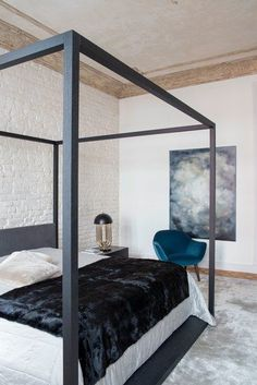 In the bedroom, an ethereal artwork by Polish talent Dorota Buczkowska is a stark contrast to the monumental four-poster bed by Antonio Citterio | archdigest.com