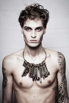 Rugged look, .Love the use of keys for a necklace, maybe a bit smaller though:)