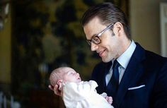 Princess Estelle held by her father, Prince Daniel
