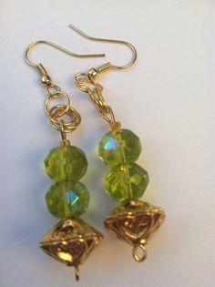 Green glass crystal and gold earrings. Handmade by DorDomGodsGifts, $10.95