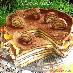 Tort de clatite cu crema de mascarpone si de vanilie si pe margini cu bucati de fructe tropicale, din compot. Desi in loc de blat de tort are clatite sper sa va incante ideea acestui tort ra…