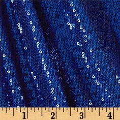 Add some glitz to your wardrobe with this sequin mesh fabric! This lightweight sequin fabric features rows of bright shiny sequins on a sheer mesh background, with about 20% stretch on the grain for comfort and ease. It's perfect for decorations, overlays, costumes, and more. Sequin Fabric, Mesh Fabric, Harley Quinn Cosplay, Overlays, The Row, Sequins, Decorations, Bright, Costumes