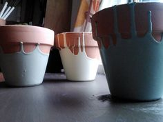 Painted Terra Cotta Pots. Paint them upside down :)