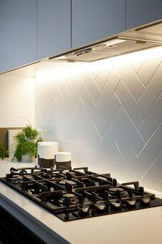 7 Creative Subway Tile Backsplash Ideas for Your Kitchen #kitchen #backsplashes #white #sinks #stove #menjaminmoore White, gray, black, red and more color glass backsplash ideas with kitchen cabinets and countertops. Glass backsplash tile photos and projects.