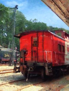 'Caboose': Fine Art Prints by Susan Savad - Many people are attracted to trains because you feel a sense of travel and adventure. This red caboose sitting at the train station makes you wish you could get on the train and go on a trip. #train #caboose AS LOW AS $32