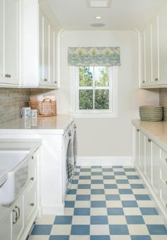 Laundry room with fabulous blue and white checkered flooring!