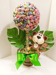Our JUMBO Safari Edible Lollipop Topiary is the perfect table decoration for your Jungle Safari event. It may be used for your candy buffet or centerpieces for your guest tables. - Each centerpiece stands about 17 inches tall! - Each centerpiece includes over 160 multi-color wrapped lollipops, possible to use one solid lollipop color. - The base is weighted down to prevent toppling - Giraffe, Elephant, Lion and Zebra also available Our pieces are made by us and are COMPLETELY CUSTOMIZABLE…