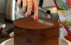 How to Ganache a Cake - This is the first in our 3 part series teaching you how to make a fondant cake right from the basics of ganaching.
