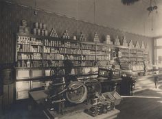 Photographer: Reuben R. Sallows (1855 - 1937)  Description:  Interior of grocery store; shelving unit filled with canned goods lines background; window on right; hanging light fixture in upper right quadrant; counter in middleground; Sallows imprint in lower right corner of matte  Object ID : 0535-rrs-ogohc-ph  View additional photographs by Sallows that are held in other collections at the Reuben R. Sallows Digital Library.