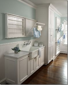 This is how I want my laundry room to look! It needs a few more storage solutions.  But it's beautiful! I love the sink area! A stackable washer and dryer creates more space.
