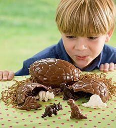 Chocolate dinosaur egg—crack it open to find milk chocolate, dark chocolate, and white chocolate dinosaurs—sweet!