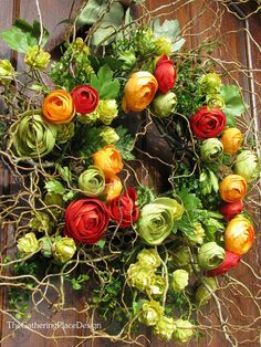 Wreath with Ranunculas, Spanish Moss and Ivy.  ranunculas are my absolute favorite!