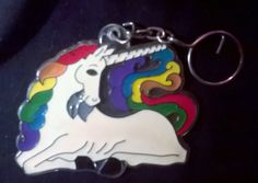 1980s Unicorn Rainbow Keychain Made with hard plastic  Measures about 8.5 cm X 7 cm  This is a used item. There could be normal wear on the item so