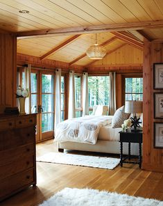 Summer Home Decorating Ideas Inspired by Rustic Simplicity of Canadian Cottages Enclosed Cottage Porch (© Janet Kimber). This has lots of elements I'd love- french doors, wood beams Cabin Homes, Log Homes, Home Design, Design Design, Design Ideas, Rustic House Design, Farmhouse Design, Block House, Lodge Bedroom