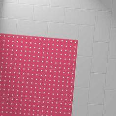 Harvey Maria Little Bricks luxury vinyl tiles in Steel grey, creating a border around the Cath Kidston Spot Red floor.