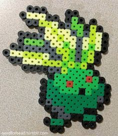 December Pokemon Challenge Day 7: POISON TYPE #043 Shiny Oddish Pokemon is managed by The Pokemon Company.For more Pokemon perler bead designs check out my Tumblr!