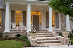 traditional exterior by Highland Homes, Inc. White washed brick steps and front porch go well with the door/shutter color. Front Porch Steps, Front Porch Design, Porch Designs, Porch Columns, Front Entry, Porch No Railing, Traditional Porch, Traditional Exterior, Colonial Exterior