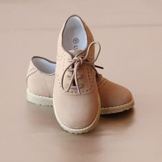 Handsome, fine nubuck khaki leather saddle oxford shoes for the young gent. Available in two tone (white/khaki) or single tone (full khaki). Toddler sizes 7-13,