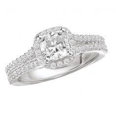 Halo Semi-Mount Diamond Ring $1,748 Style: 115038-100 Cushion Style Halo Diamond Engagement Ring in 14kt White Gold with a V Shank . (D.1/3 carat total weight) This item is a SEMI-MOUNT and it comes with NO CENTER STONE as shown but it will accommodate a 5.5mm cushion cut center stone.