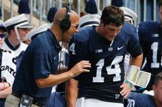 PENN STATE – FOOTBALL 2014 – Penn State quarterback Christian Hackenberg (14) listens to head coach James Franklin during a timeout in the second quarter of an NCAA college football game against Akron in State College, Pa., Saturday, Sept. 6, 2014. (AP Photo/Gene J. Puskar)