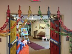 Workshop of Wonders VBS - paint strokes with paintbrushes and paper chains for doorways.