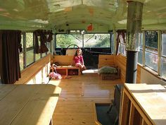 school bus refurbished into a rv/camper there's a wood stove inside