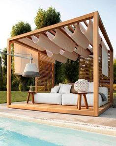 Get the perfect custom pergola shade for your delight. Find the pergola pool designs that suit the space you want to create! Go to backyardmastery.com for more ideas.