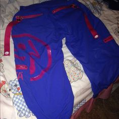 Zumba cargo pants Blue and pink Capri pants. Has cute Zumba logo on the side. And comes with tassles. Small Zumba Pants Track Pants & Joggers