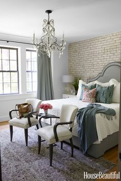 In the master bedroom of an Birmingham, Alabama, a pair of chairs by Lee Industries is covered in the company's Serengeti with leather piping.   - HouseBeautiful.com