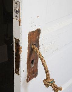 Above:A length of knotted rope serves as a door handle.