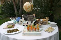 around the world baby shower theme ideas, decorations, map mat, treats with elephants, dessert table