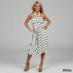Comfortable meets stylish in the design of this stretch cover-up dress that is available in several colors and patterns. It is made from a soft blend of polyester and spandex and can be worn as a dress, a skirt, or even a bathing-suit cover-up.