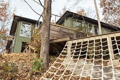 How This Landscape Design Made a Home as Fun as a Playground - Photo 7 of 15 - Another backyard hotspot is the deck, built around an existing boulder, where adults can lounge while the kids climb.