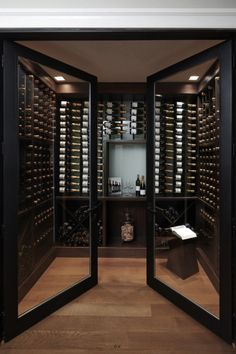 The double glass doors on this wine cellar add a sort of elegance to the libations. Cave A Vin Design, Wine Cellar Design, Wine Cellar Modern, Glass Wine Cellar, Modern Wine Rack, Home Wine Cellars, Wine Display, Wine Wall, Wine Storage