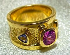 Pink Sapphire with Blue Trillion Sapphires bezel set in Primitive Ring. robertyoung.com