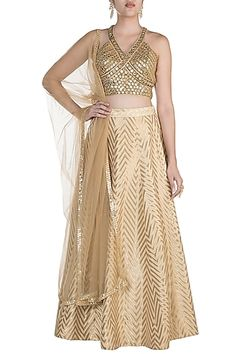 Featuring a golden backless blouse in silk base with mirror work hand embroidery. It is paired with a matching lehenga skirt and dupatta in net base. FIT: Fitted at bust and waist. CARE: Dry clean only. Lehenga Skirt, Lehenga Choli, Indian Fashion Designers, Indian Designer Wear, Lehenga Designs Latest, Sweet Wedding Dresses, Wedding Wear, Mirror Work Blouse, Baby Shower Dresses