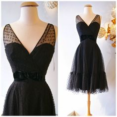 Early 1960s polka dot tulle cocktail dress with sweetheart neckline. Via Xtabay Vintage Clothing Boutique.
