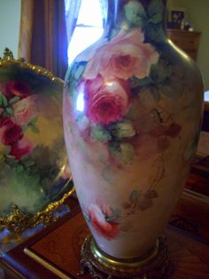 I am pleased to offer for your consideration an old Absolutely Beautiful Hand Painted Limoges Lamp Vase on a decorative bronze base, in excellent