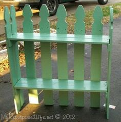 Easy DIY Garden Projects - Reclaimed picket fence into a cute garden shelf.  http://thegardeningcook.com/easy-diy-garden-projects/