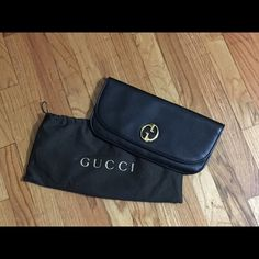 Gucci 1973 clutch The product is new and in beautiful condition inside and out without any flaws. Black leather suede lining, inside open pocket. Gucci Bags Clutches & Wristlets