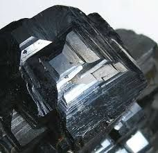 Magnetite.Colour:	Greyish black or iron black . Hardness (Mohs):	5½ - 6½.