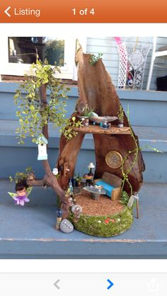 Fairy house made from a palm tree seed pod. So cute!