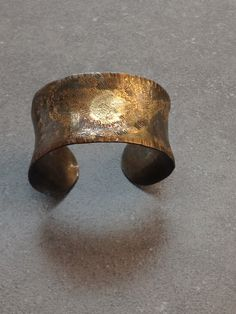 Iron cuff, etched and textured. Fused with 22k gold and Egyptian Electrum (50-50 gold silver). Love the Japanese Brown patina! SOLD