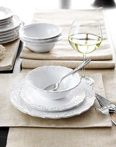 Dishes; Natural fibers and embossed patterns brighten the spring table.